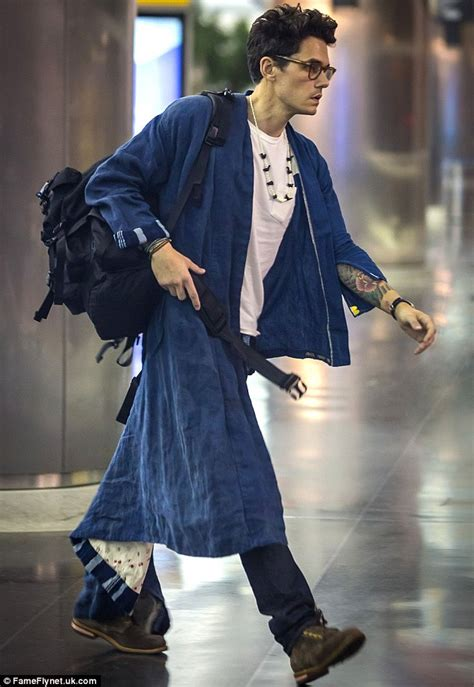 John Mayer emerges in bathrobe after flight to New York's
