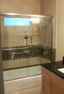 glass doors small bathroom:  surround with glass shower doors incorporates small window over tub