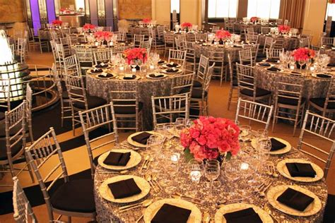 Hot pink centerpieces punctuated the black and silver decor scheme.