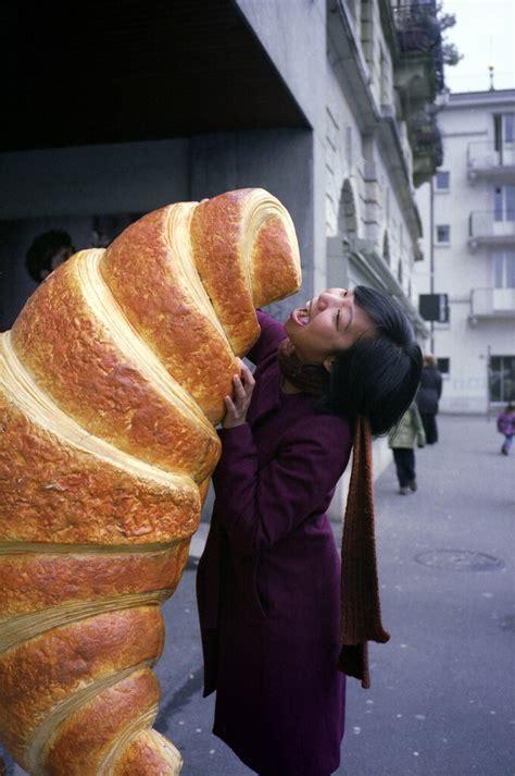 girl eating giant croissant   title  sense  flickr