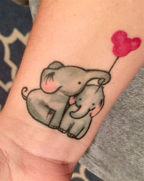 baby elephants tattoo in honor of my sons family mickey