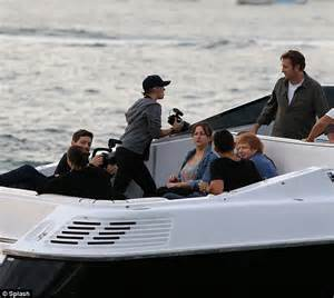 ed on a boat ed sheeran puffs on a cigarette en route to sing at