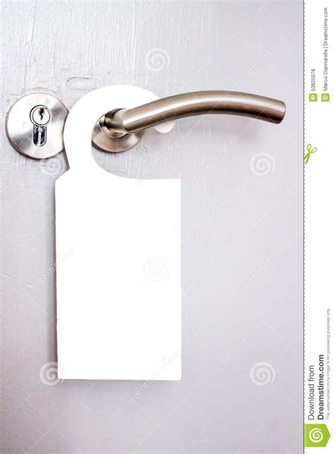 white signal hanging on a door handle of hotels stock