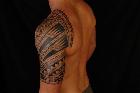 tribal quarter sleeve tattoo religious half sleeve tribal designs
