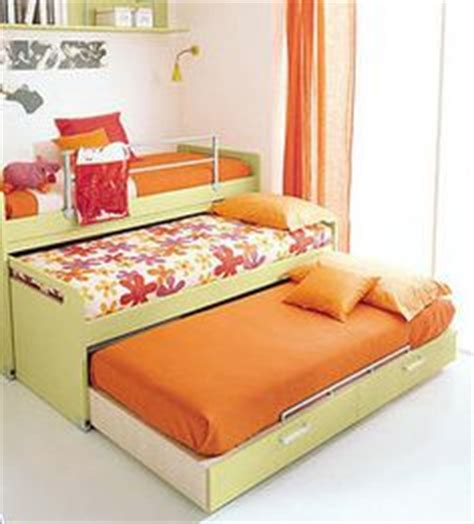 2 beds in 1 girls bedroom on pinterest trundle beds shared bedrooms