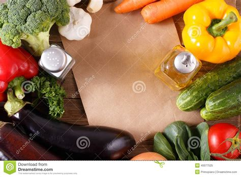 vegetables on wood background with space for recipe stock