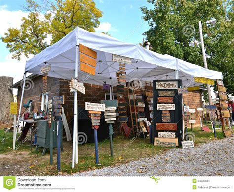 wood scow craft show with carved signs editorial stock image image
