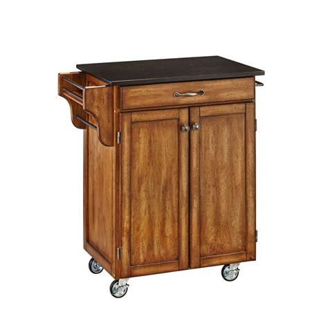 americana kitchen island black the home depot canada create a cart cottage oak with black granite top the