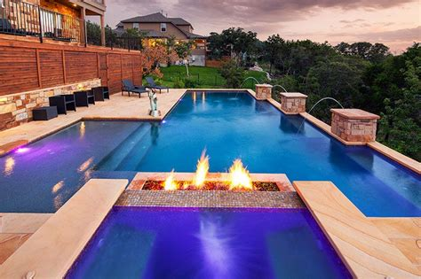 geometric pools geometric pool with fire feature columns with jets