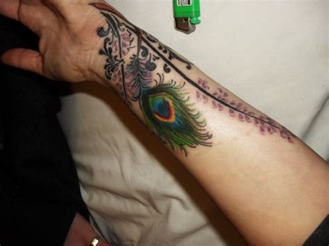 feather tattoo hand meaning peacock feather tattoo on hand tattoomagz