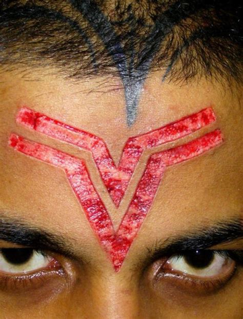 logo tattoo on forehead 57 body scarification tattoos