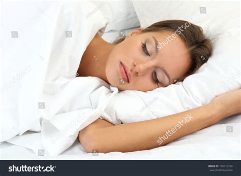 woman sleeping in bed young beautiful woman sleeping in bed stock photo
