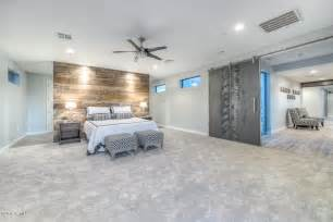 contemporary master bedroom with ceiling fan amp carpet in
