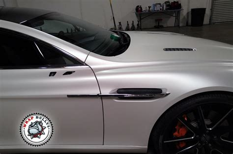 white wrapped aston martin rapide wrapped in satin pearl white wrap