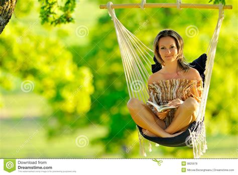 women and swinging beautiful young woman swinging outdoor royalty free stock