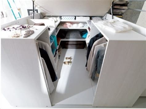 smart space saving bed hides a walk in closet underneath there s a whole universe of closet space hidden under this