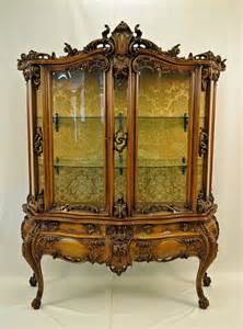 rococo style vitrine with curved glass furniture