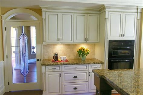cream cabinets kitchen antiqued cream kitchen cabinets traditional kitchen