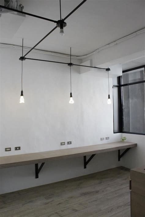 desk lighting ideas include workbench with high stools in reception area for