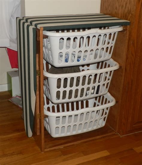 white laundry basket dresser with a drop