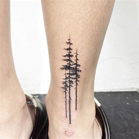 achilles heel tattoo pine trees on the right achilles heel artist