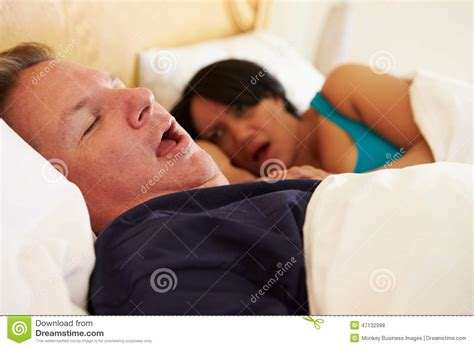 bed man couple asleep in bed with man snoring stock photo image