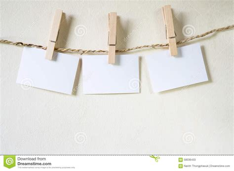 Paper String - three squares of blank paper stock photo image 58036433