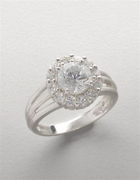 Cincin Forever21 Flower Zircon lord sterling silver and cubic zirconia flower ring in metallic lyst
