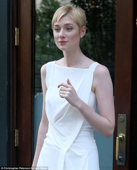 Elizabeth Debicki checks her locks are in place as she