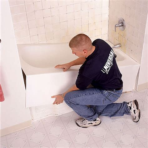 how to install a bathtub liner video tipsnips set a bath tub
