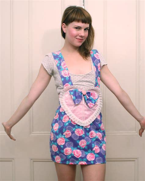 feminine preteen boy purple rose print heart and suspenders skirt