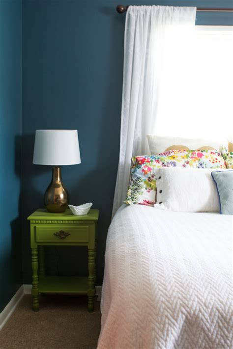 simple guest room bright painted stand and teal walls in this simple guest room ikea decora