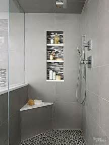 small corner bench in a modern gray walk in shower