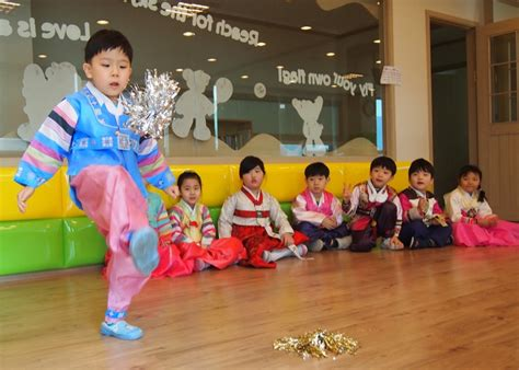 korea during new year seollal a child plays jaegi chagi a korean hackey
