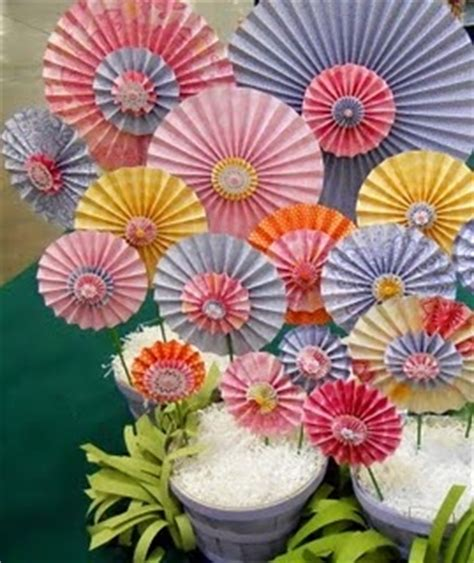 Paper Folded Flowers - folded paper flowers could be scaled up for a