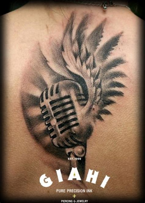 tribal microphone tattoo back wings microphone by giahi