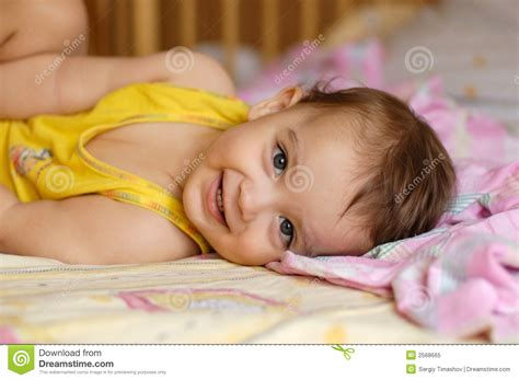 lying on bed baby lying on bed royalty free stock photo image 2568665
