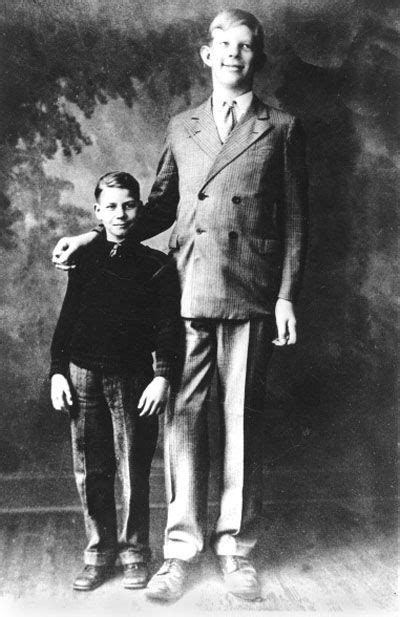 Robert Wadlow, 10 years old standing next to an average