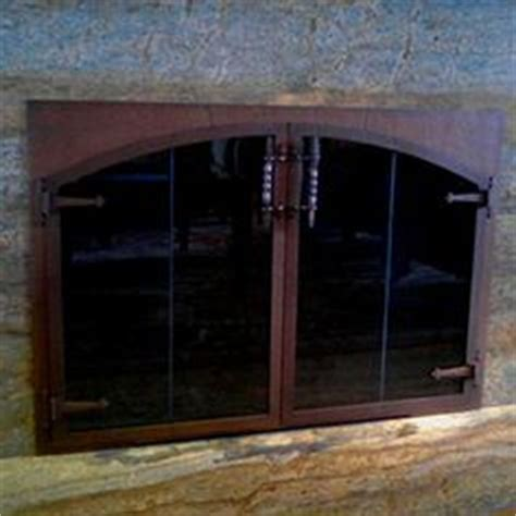 Design Specialties Glass Doors Design Specialties Custom Hammered Steel Fireplace Glass Doors In Copper Finish By Southern