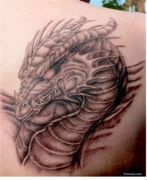 dragon head tattoo realistic on the back