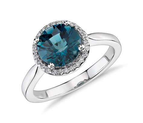 blue topaz and halo ring in 14k