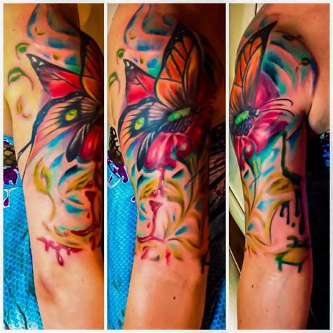 trippy melting flower and monarch tattoo tattoos