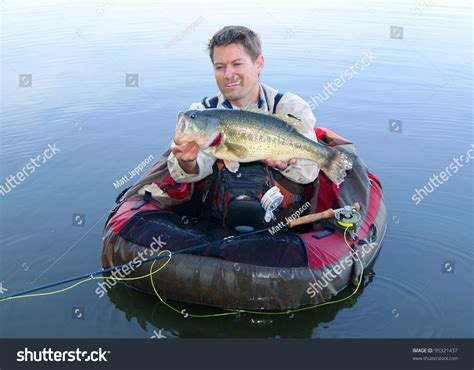 boat fly rod tubes fly fisherman pontoon float tube belly stock photo