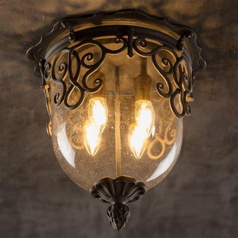handgeschmiedete leuchten deckenleuchte mit glas kuppel und schmiedeeisen ornamenten