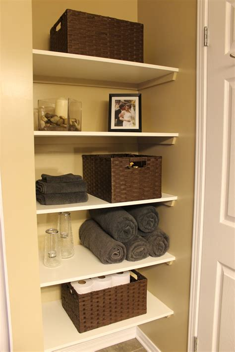 bathroom closet shelving km decor diy organizing open shelving in a bathroom