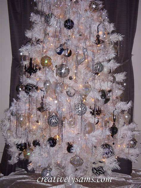 tree with black ornaments how to keep cats away from your tree