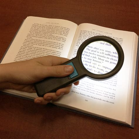 magnifying glass with light for macular degeneration held illuminated magnifying aids magnifiers