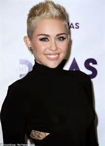 super short growing out hair miley cyrus conceals her growing hair with a chic chanel