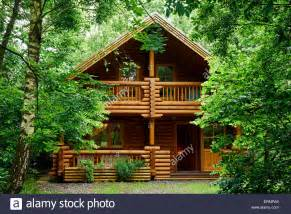 a wooden log cabin in the woods in bryseincyn in anglesey