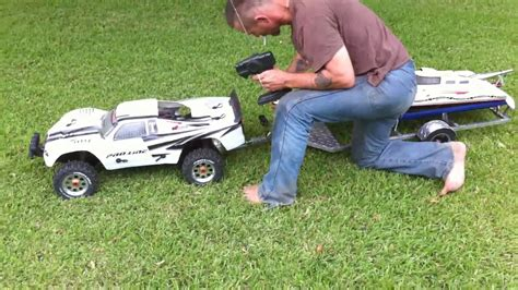 rc trucks with boats 1 5 scale rc baja truck pulling 48 inch gas rc boat on
